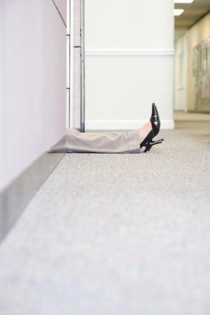 businesswoman legs: Legs of woman lying on floor