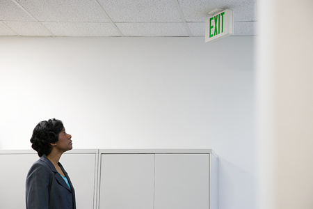 exit sign: Woman looking at exit sign