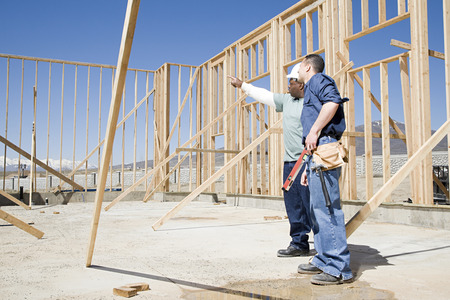 home decorating: Builders on construction site Stock Photo