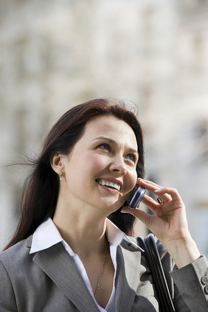 earing: Businesswoman on cellphone Stock Photo