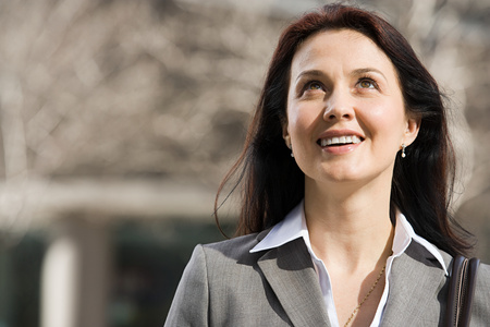 earing: Businesswoman looking up