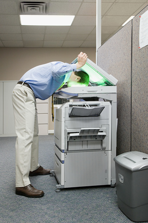 Man photocopying his head