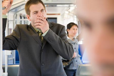 korean ethnicity: Commuter yawning Stock Photo