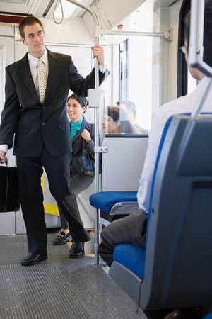 People boarding light rail