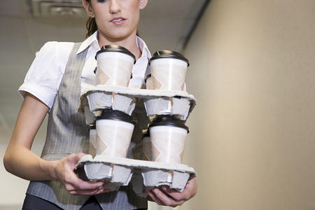 carrying: Woman carrying coffee cups