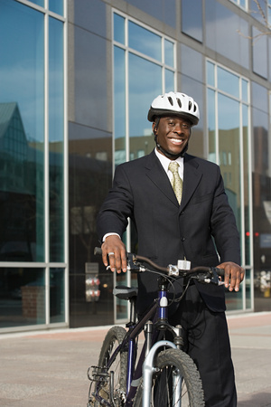 one mid adult man: Businessman with bicycle