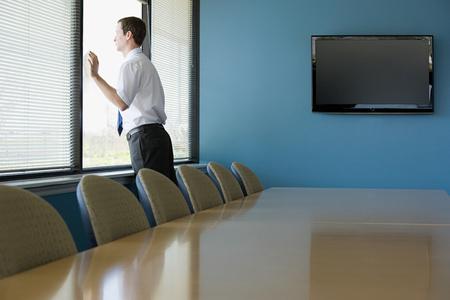 looking through window: Office worker looking through window