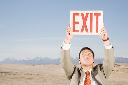 exit sign: Man in desert with exit sign