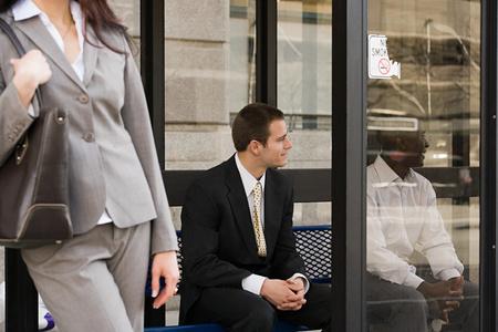 handheld computer: People waiting at bus stop