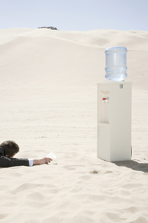 water cooler: Man by water cooler in the desert