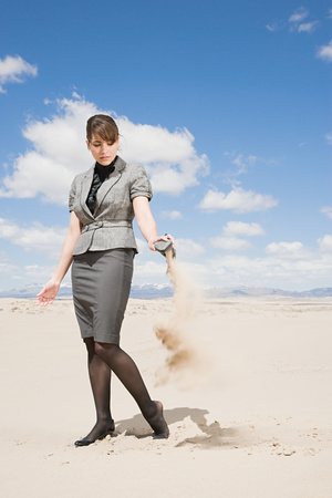 days gone by: Woman emptying sand from her shoe Stock Photo