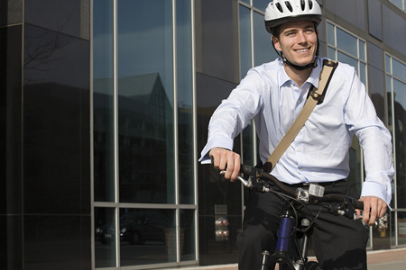 Office worker riding bicycle