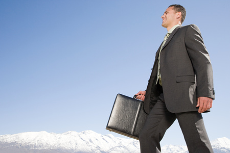 pacific islander ethnicity: Businessman by mountains Stock Photo