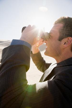 oversee: Businessman with binoculars