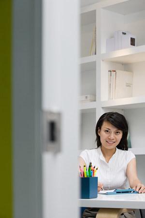 open plan: Female office worker Stock Photo