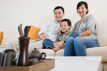 family with one child: Family watching tv Stock Photo