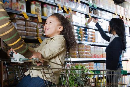 three shelves: family shopping in a supermarket Stock Photo