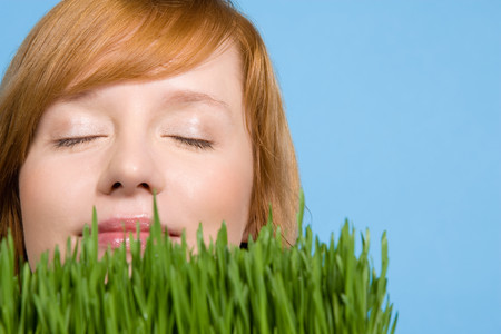 smelling: Woman smelling grass