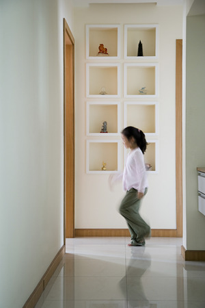 one room school house: Girl walking in a corridor Stock Photo