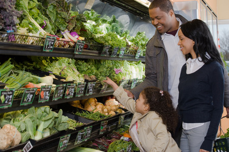 differential focus: family shopping in a supermarket Stock Photo