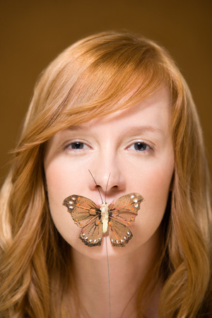 covering: Butterfly covering womans mouth