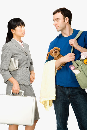 role reversal: Businesswoman and husband Stock Photo