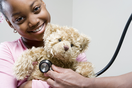 child patient: Girl and teddy with stethoscope