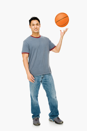 flying man: Man with basketball Stock Photo
