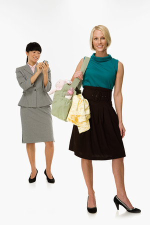 handheld computer: Businesswoman and mother Stock Photo