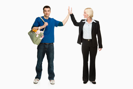 reversal: Businesswoman and husband Stock Photo