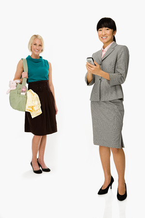 handheld computer: Mother and businesswoman