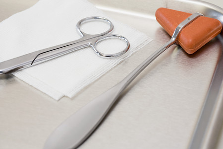 gauze: reflex hammer scissors and gauze