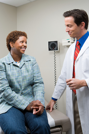reassurance: Woman with doctor