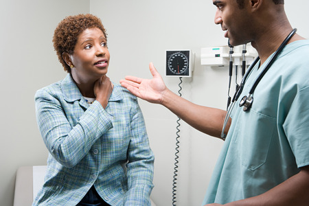 hospital patient: Woman talking to doctor