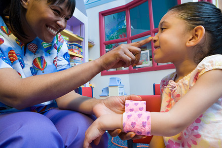 chinese american ethnicity: Nurse caring for girl