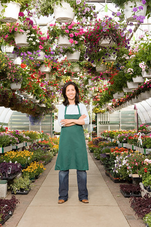 shop assistant: Shop assistant in a green house