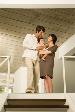 Family standing at the top of stairs