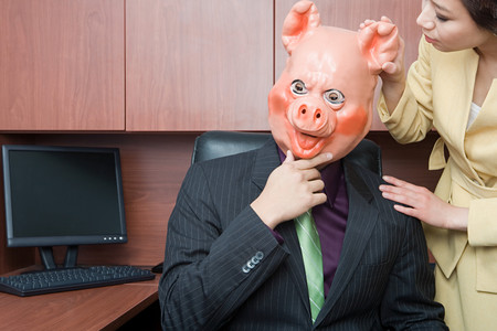 concealment: Businessman in pig mask and businesswoman Stock Photo
