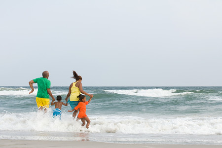 leisure time: Family jumping in the sea