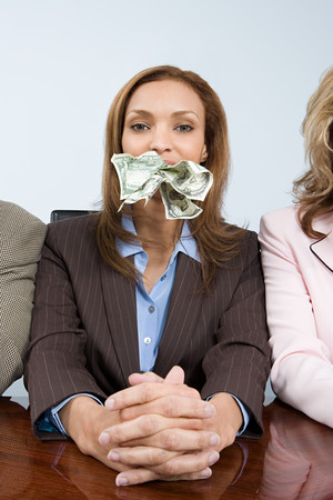 Businesswoman with money in her mouth Stock Photo