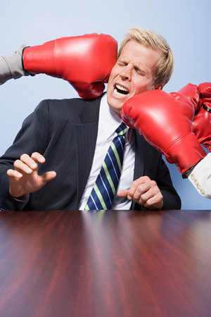 punched: Businessman getting punched