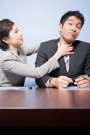 image source: Businesswoman strangling businessman
