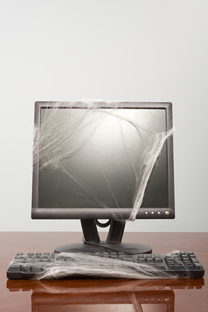 Computer covered in cobweb Imagens