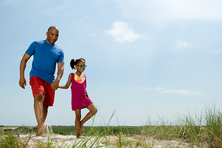 african ethnicity: Father and daughter walking Stock Photo
