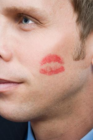 cheek to cheek: Man with lipstick kiss on cheek