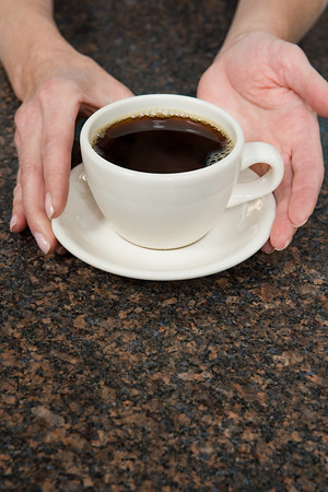 korean ethnicity: Person holding coffee cup