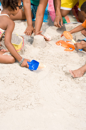 sandcastles: Family making sandcastles Stock Photo