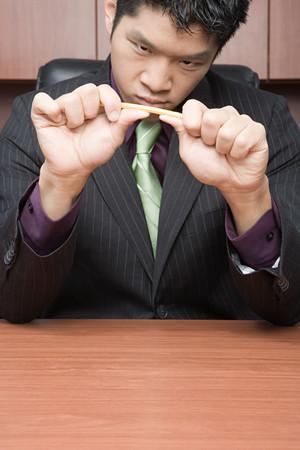breaking: Businessman breaking pencil Stock Photo