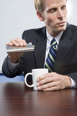hip flask: Businessman holding hip flask Stock Photo
