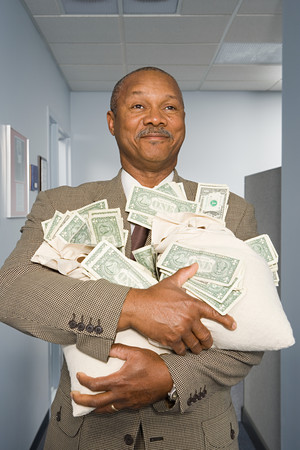human source: Businessman holding money Stock Photo